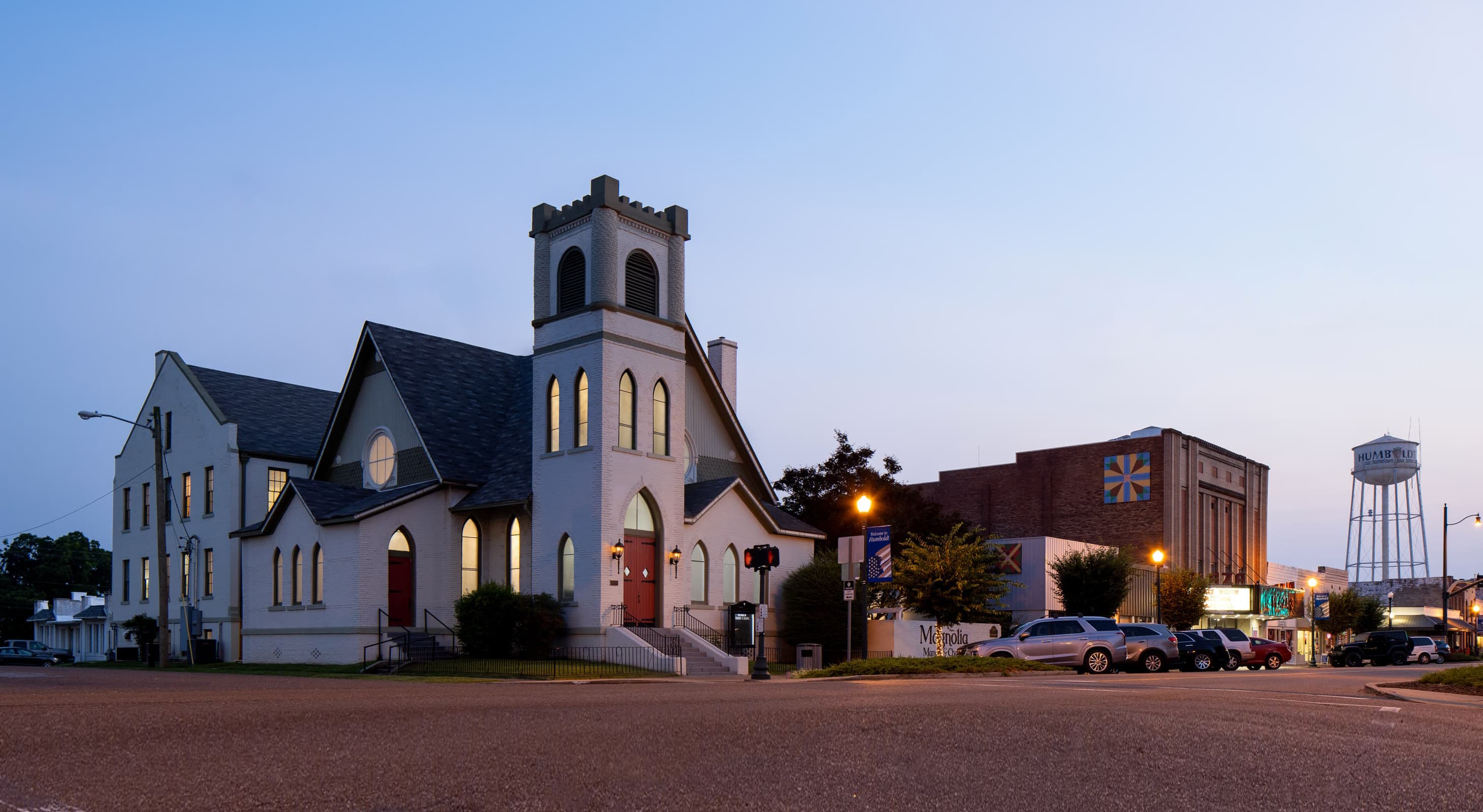 exterior of old church wedding venue at dusk