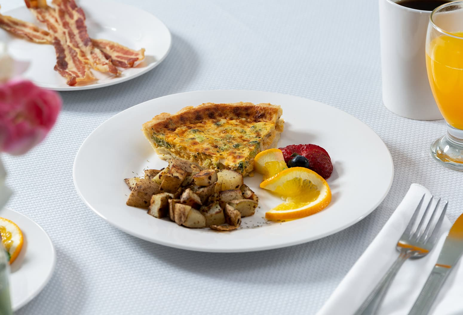 breakfast quiche with potatoes and fruit